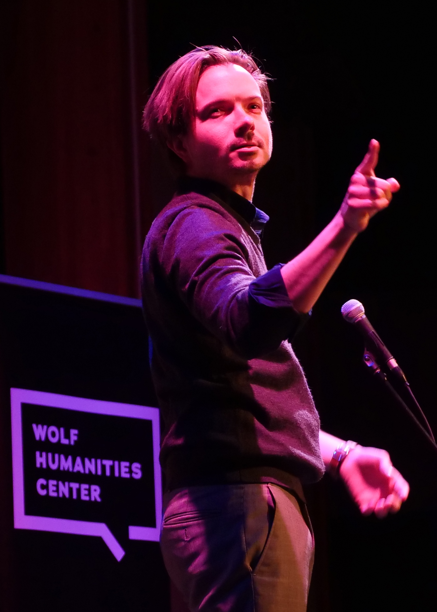 Wink on stage at Deaf/Hearing Story Slam