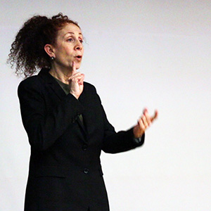 ASL interpreter at Wolf Center lecture