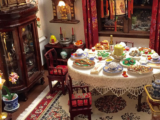 Still from Forever Chinatown, a shot of a doll house designed to look like a Chinese household in 1940s United States