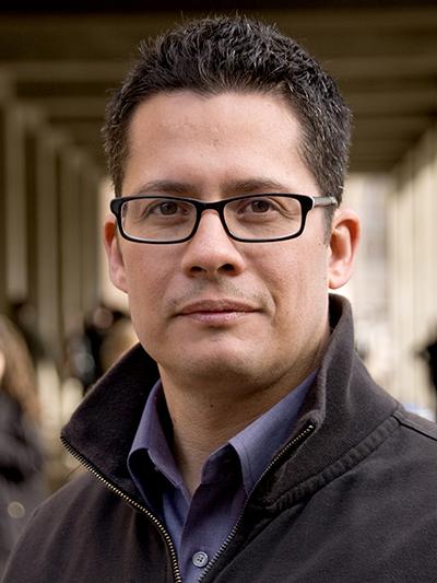 Roberto Gonzalez standing in front of a school hallway