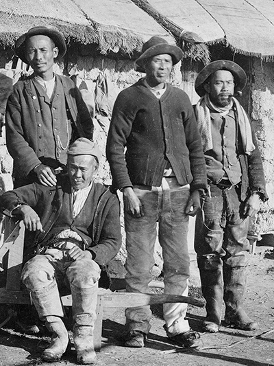 black and white photo of Chinese miners
