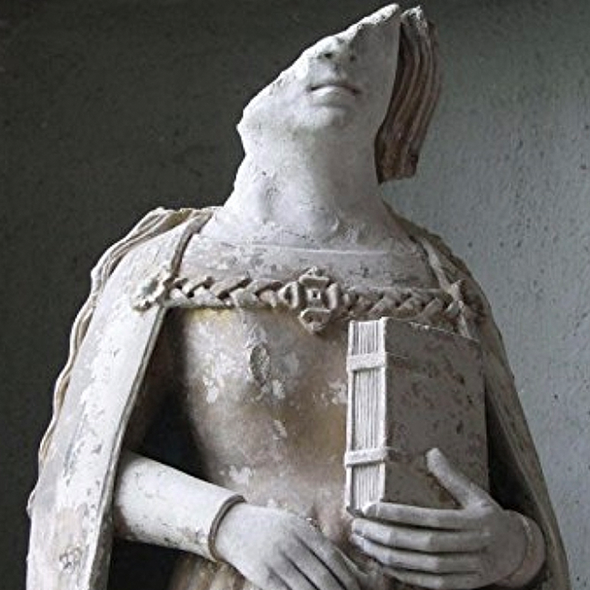 Statue of a woman from reformation era Europe with part of the face missing