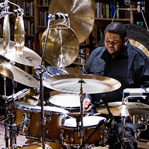 Environmental portrait of Tyshawn Sorey playing drums