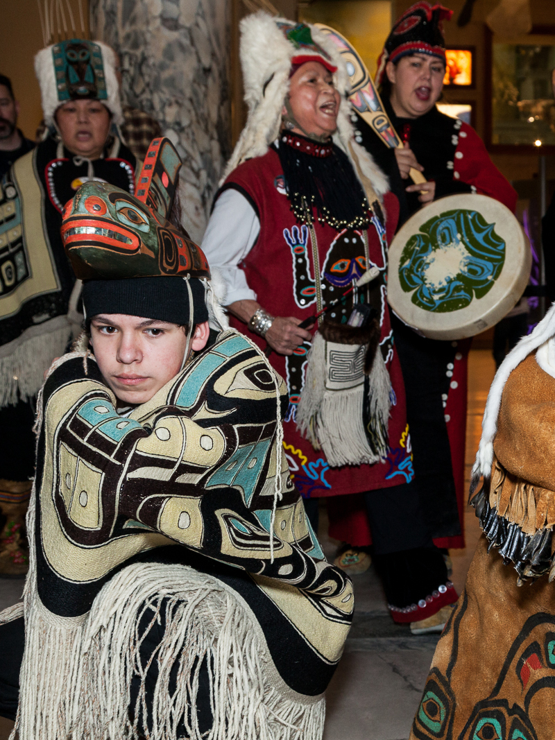 Indigenous dancers and musicians in regalia.