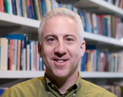 Steven Epstein in front of a Bookshelf