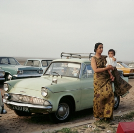 \Indian Woman Holding Child With Midcentury Cars