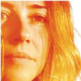 Film poster of Return (dir. Liza Johnson, 2011, 97 min.) Headshot of lead actress Linda Cardellini in orange and brown hues