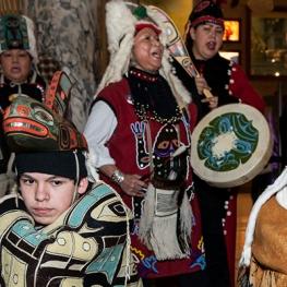 Indigenous dancers and musicians in regalia.