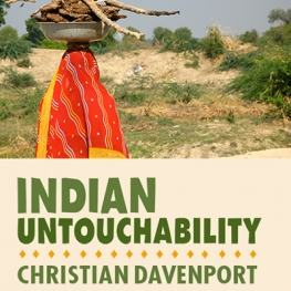 Event poster for Indian Untouchability with Christian Davenport. Woman in an orange sari carrying a bundle of sticks on her head