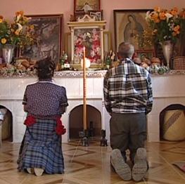 Elder religious couple praying