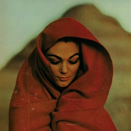 Young Woman with Red Body Wrap in the Desert
