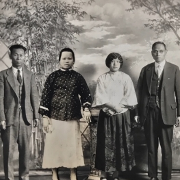 Film still from Vanishing Chinatown. Antique photo collage of Chinese family in a photography studio.